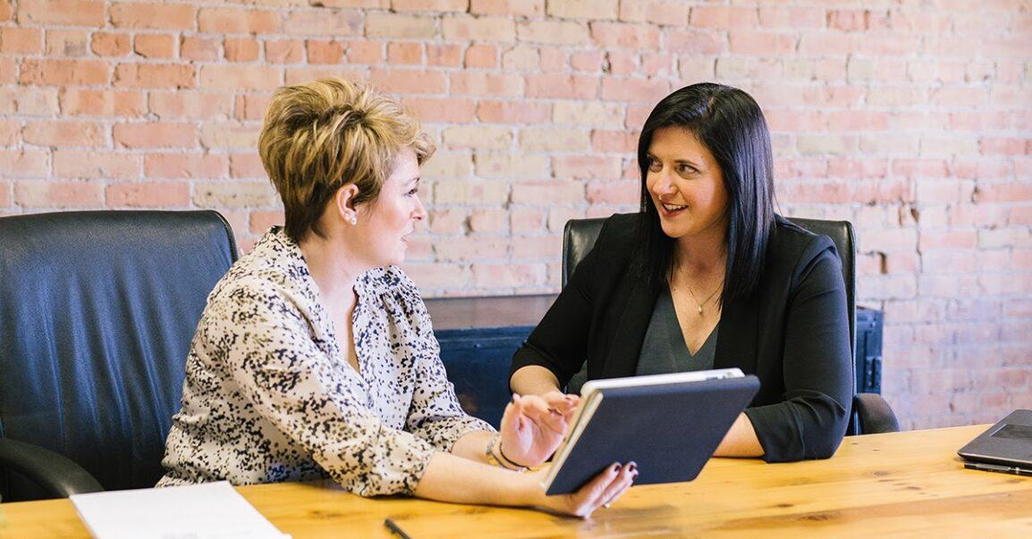 You need to outsource for growth in your business. This is a photo of a business owner and one of her support team, taking on tasks that are not in her zone of genius.