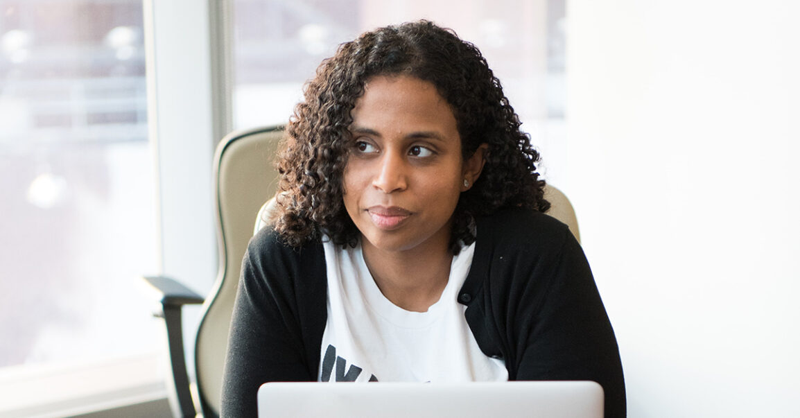 Woman sitting at her desk, wondering why she isn't making more money