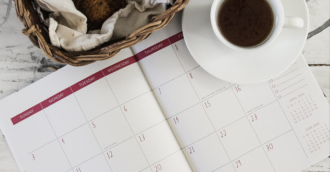 calendar with basket of muffins and a cup of coffee or tea